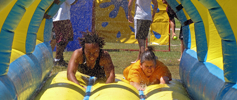 Students enjoy a waterslide during a USC Salkehatchie activity