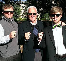 Dan Brown and his 2 children display their Carolina rings.