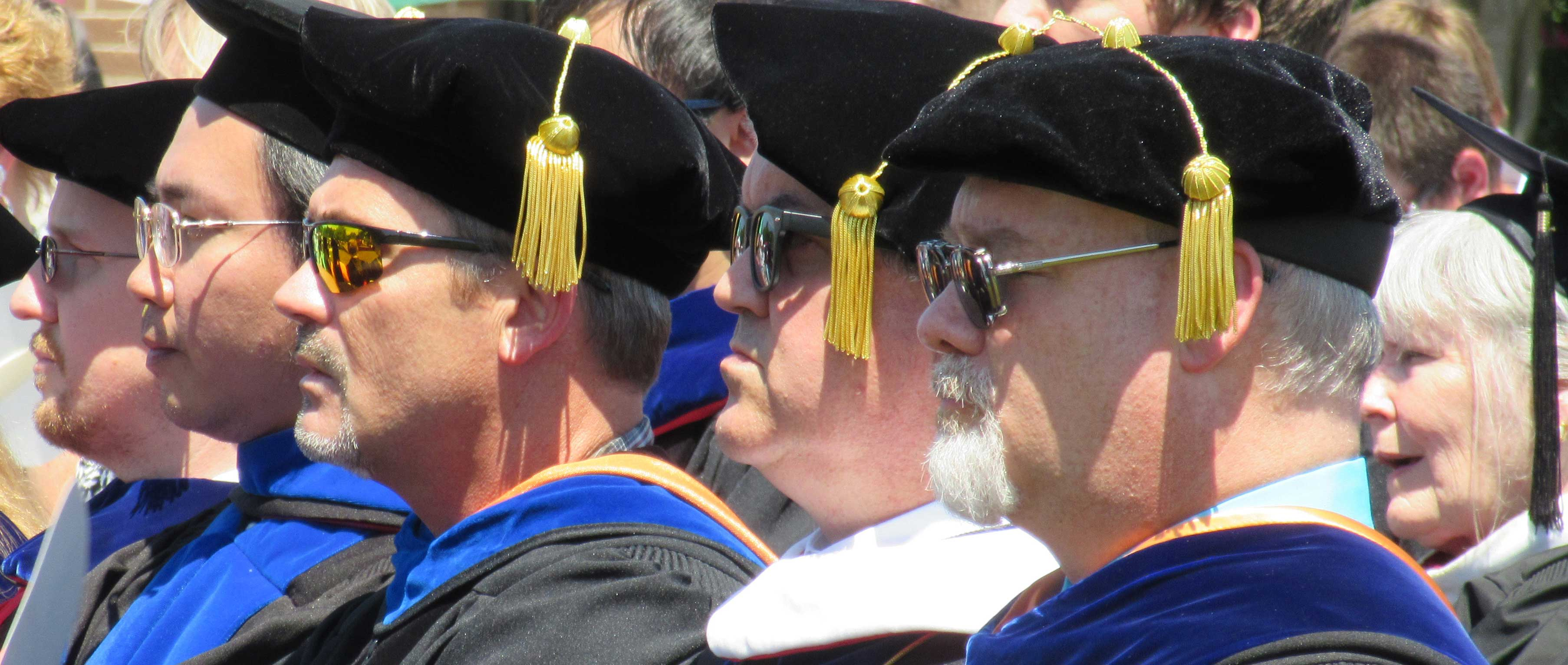 Faculty members in full regalia during commencement exercises.