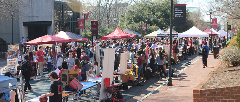 Greene Street filled with students and tents during Student Organization Fair