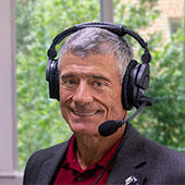 Bob Caslen wearing a headset with microphone