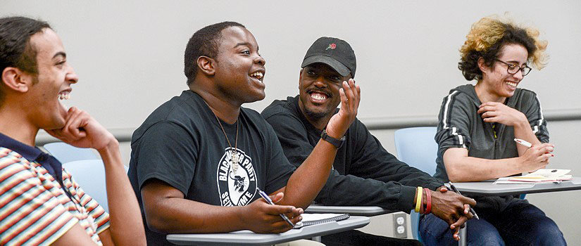 students laughing and smiling in class
