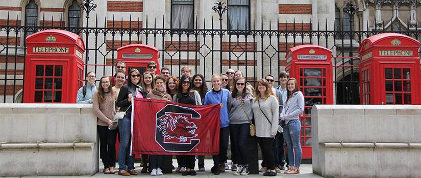 Students holding a USC flag in London