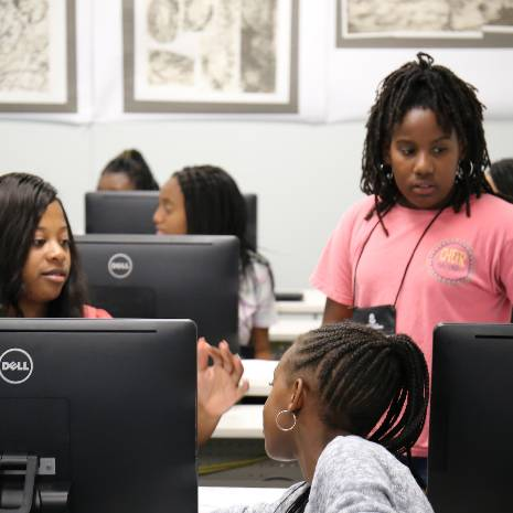 girls working in computer classroom