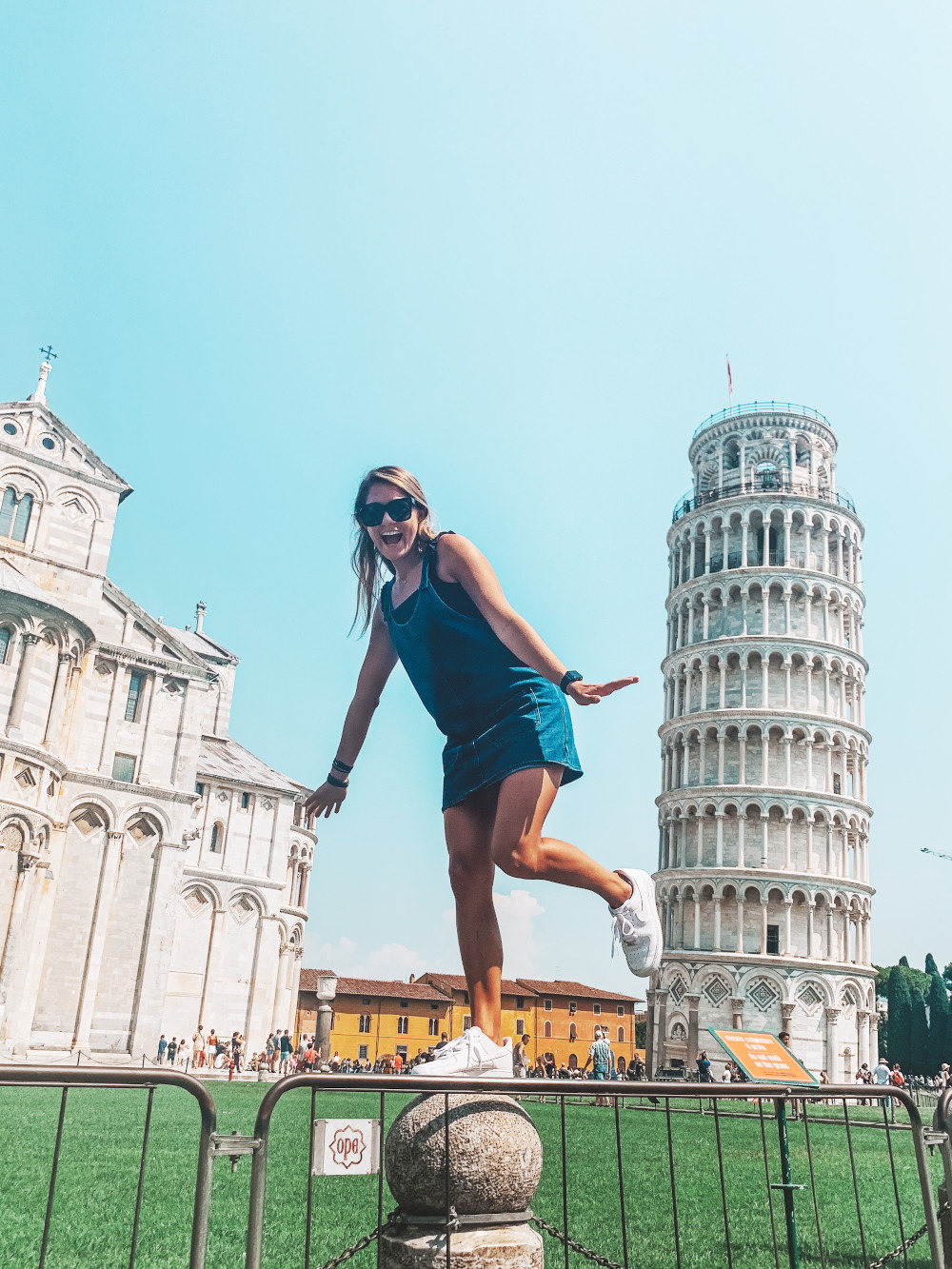 Lilly Kays balances near the Leaning Tower of Pisa