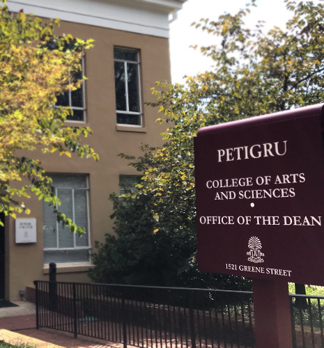 Sign for pettigru stands before the building housing the Dean's Office