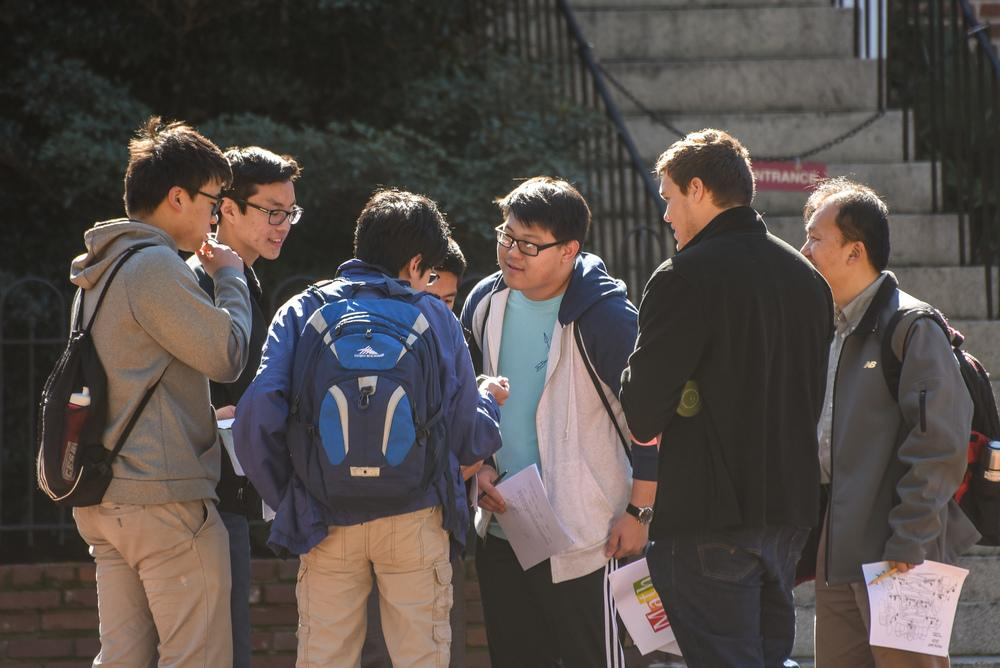 Students discussing a math problem in the park