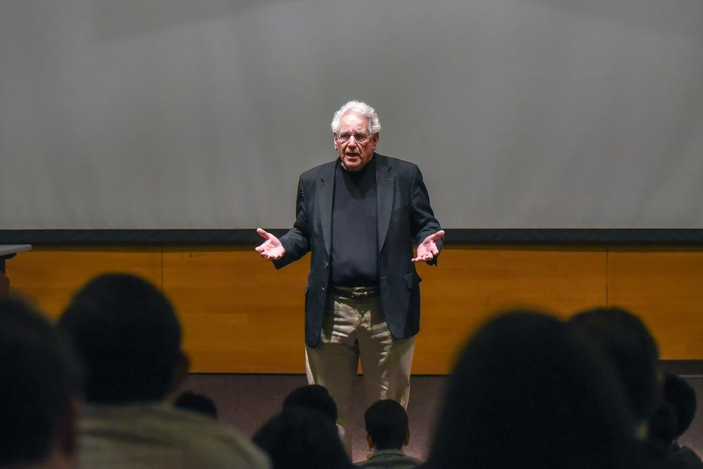 Professor speaking in front of a classroom