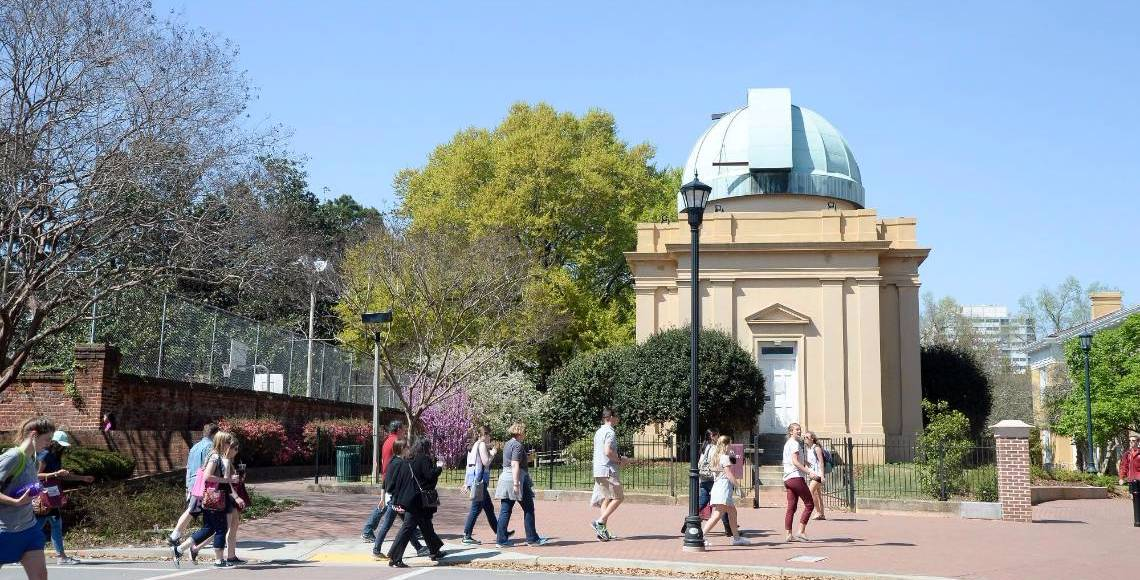 Students walking in front of the Melton Observatory