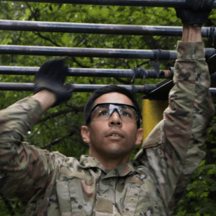 Soldier crossing monkey bars