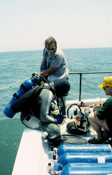 Project diver getting ready to roll off the boat and descent to the Hunley site. (SCIAA photo)