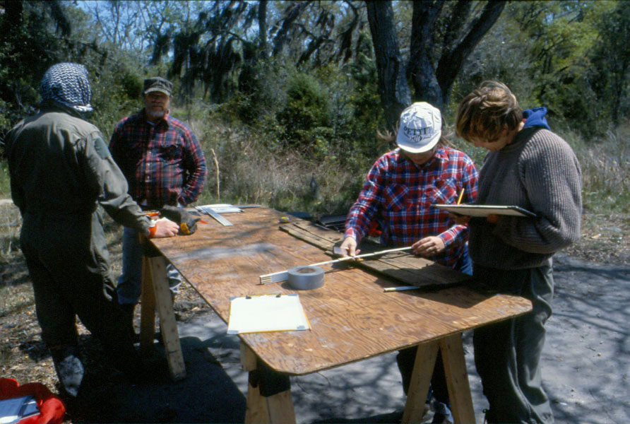 Recording a disarticulated element from the wreck on the field desk. (SCIAA photo)