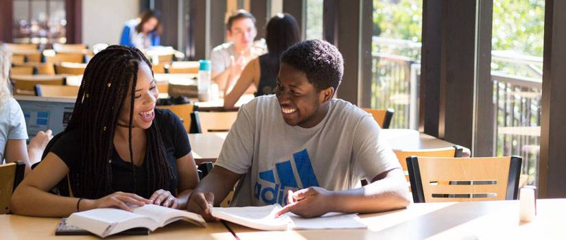 Students studying and laughing at Russell House table