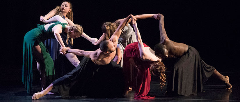 Students perform a contemporary dance work.