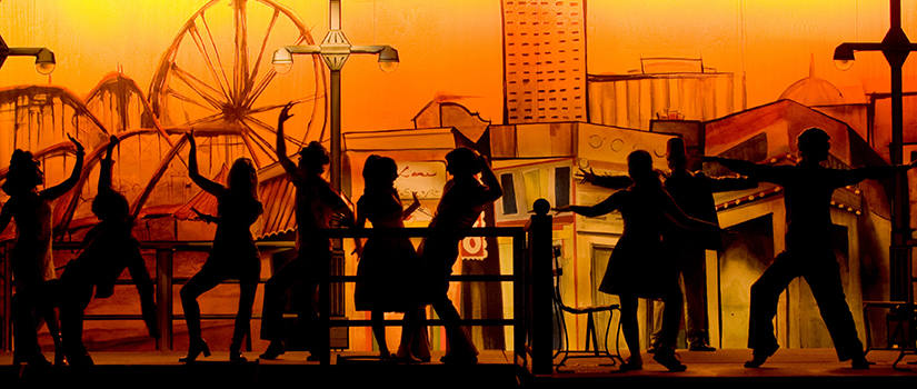 Students in silhouette in a production