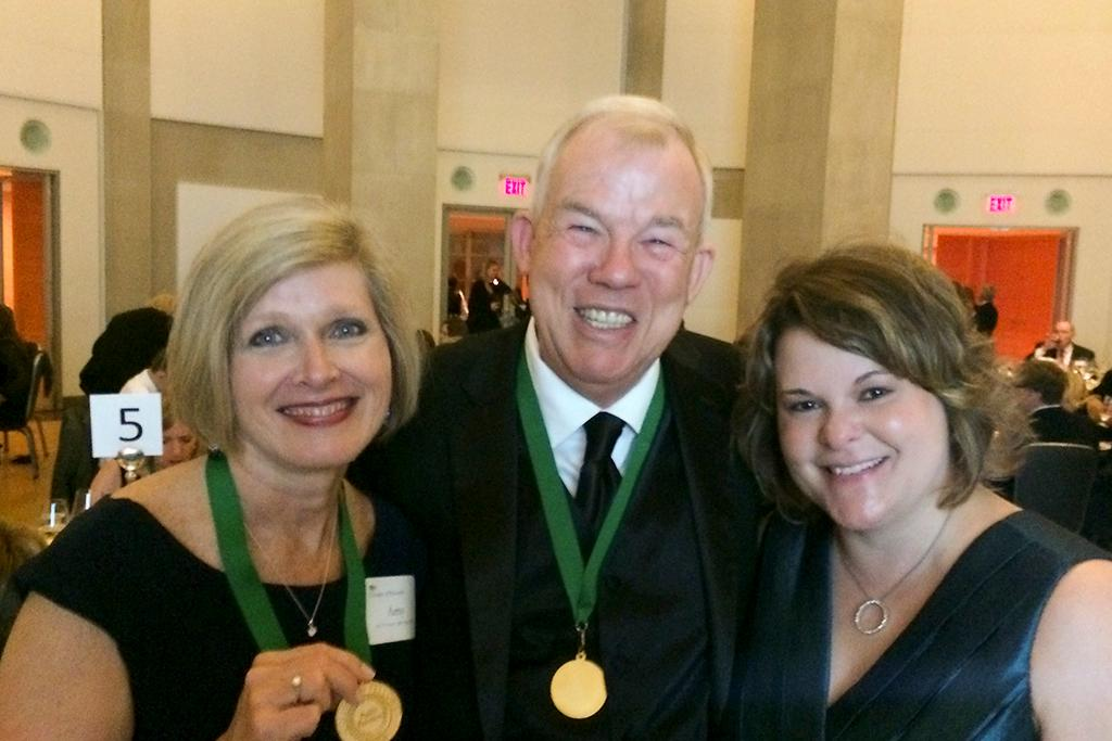 Amy Coward (MA '87), George Johnson (MA '96) and Kelly Davis (MMC '98) at Coward's PRSA College of Fellows induction ceremony in 2014.