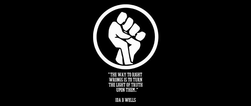 In the shape of a lightbulb, a drawing of a fist and underneath it a quote from Ida B. Wells: The way to right wrongs is to turn the light of truth upon them.