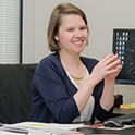 smiling woman at desk