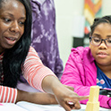 African American teacher and student in STEM classroom