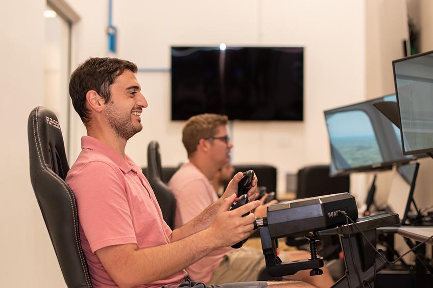 A student flies the McNair Center's flight simulator.