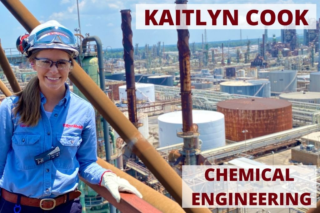 Kaitlyn wears a hardhat and an Exxon Mobil shirt and stands on a tall structure overlooking a large factory