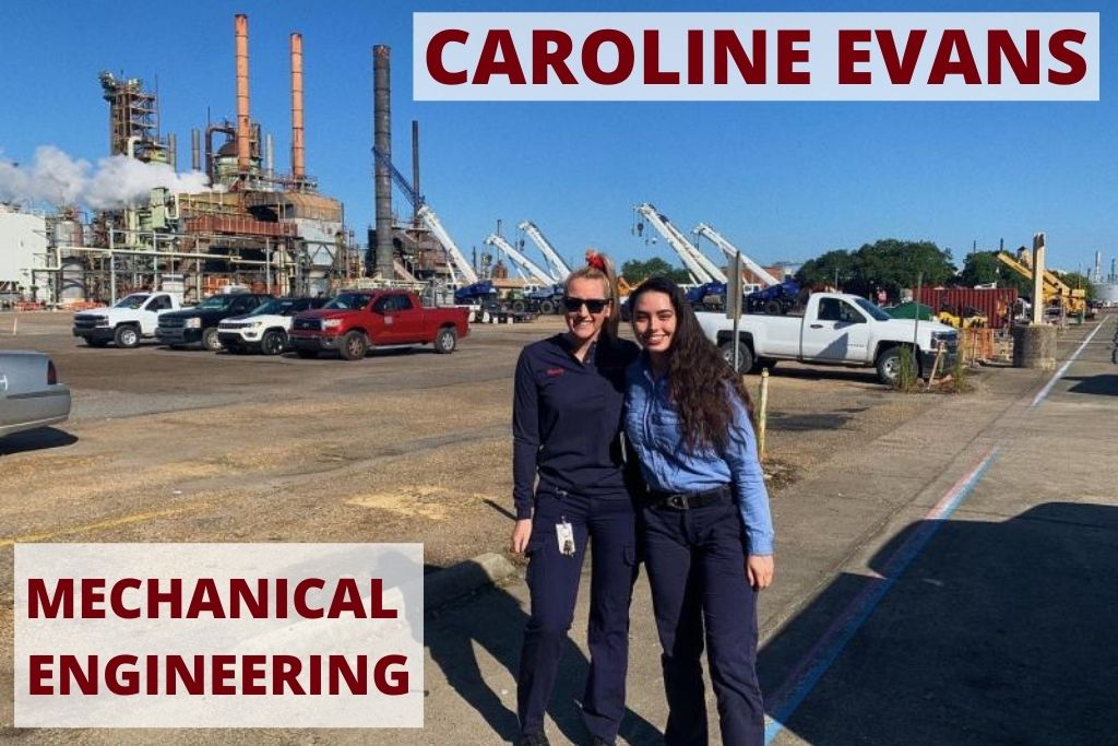 Caroline poses with a friend outside a large plant where she interned.