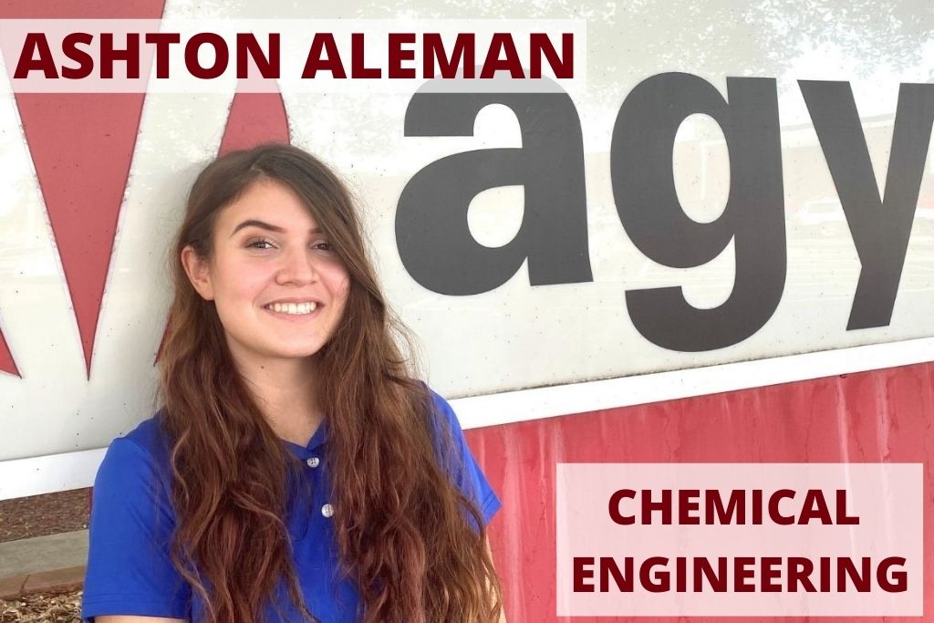 Ashton stands in front of the AGY sign at her internship.