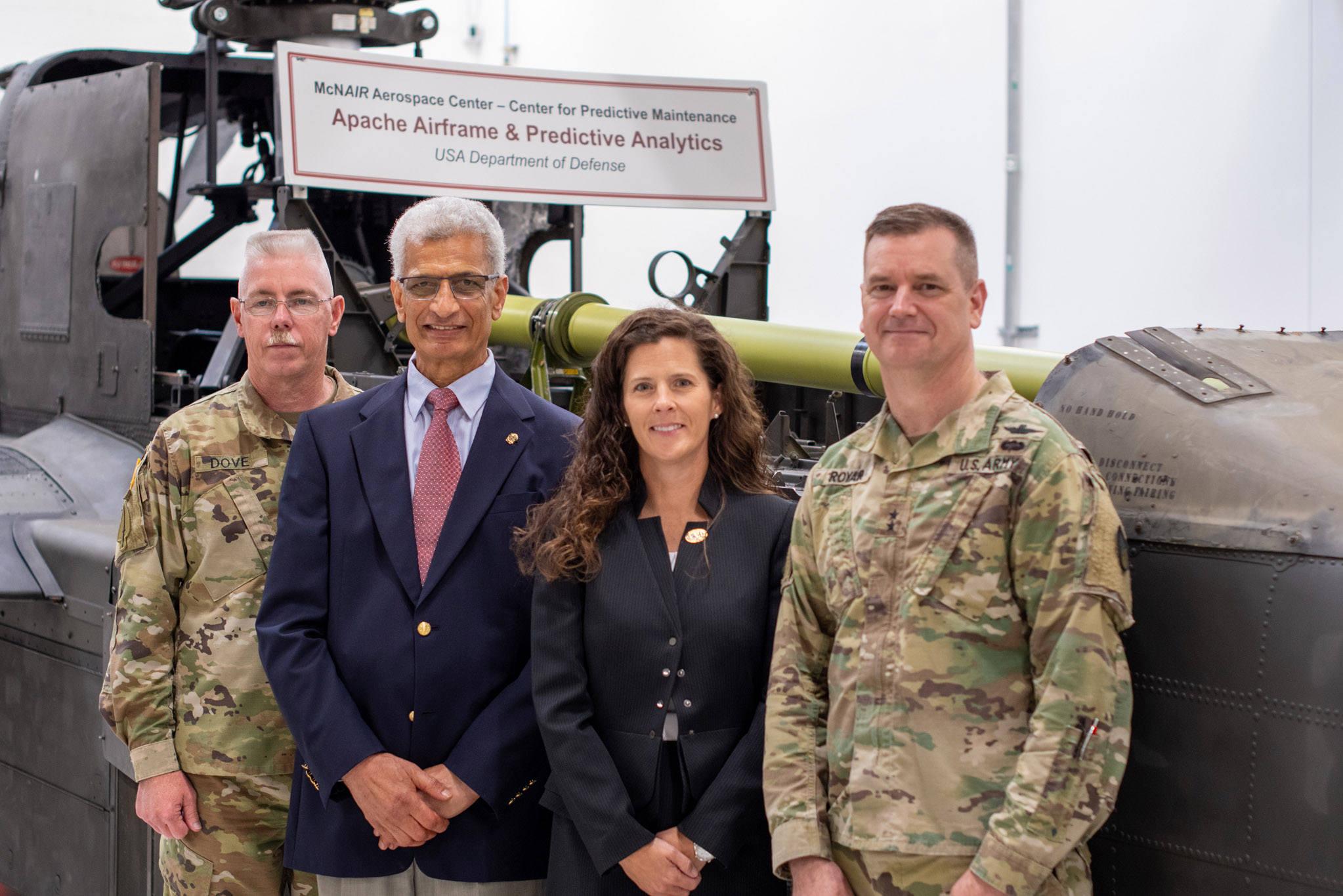 Sarj. Maj. George Dove, Dr. Bayoumi, Senior Sustainment Advisor Ms. Cindy Ponder , AMCOM Commander Maj. Gen. Todd Royar and FVL CFT stand together.