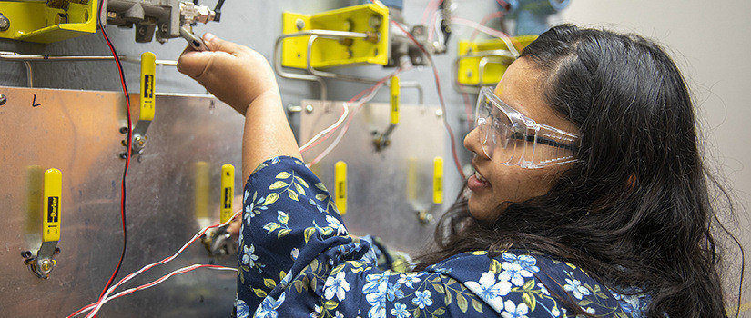 a female student works with eqipment