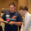 recruiter talks to student at a career fair