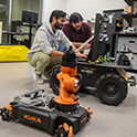 two students program a robot
