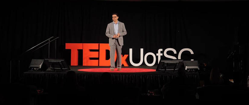 Caicedo stands on TEDX stage