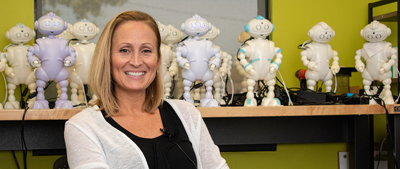Laura Boccanfuso poses in front of her ABii robots