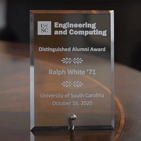 clear Distinguished Alumni plaque sits on a table