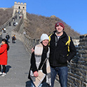 Two people pose on the great wall of China