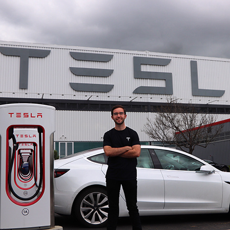 AnBrian Youngblood outside Tesla Building