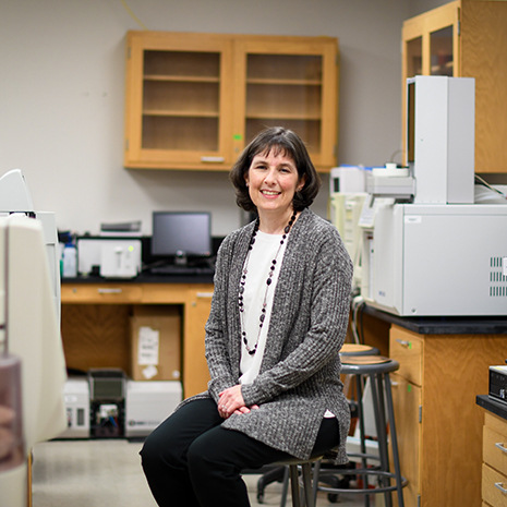 Dr. Berge sits in her lab