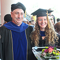 Kate Mingle poses at her graduation with Dr. Lauterbach