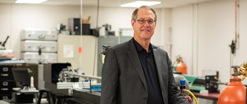 Michael Sutton stands in his laboratory.