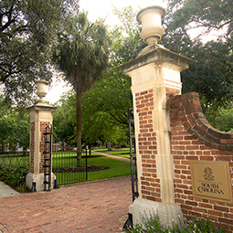 Two brick columns with a UofSC plaque on one side at the open entrance to the Horseshoe area of campus.