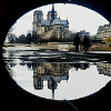 "Notre Dame Cathedral in Paris by Stephen Cupschalk ""The photo is a reflection photo of the Notre Dame Cathedral that is framed by the arch of a bridge that goes over a walkway next to the Seine river."""