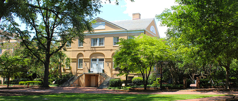 McCutchen House sits on the edge of the lush green lawn and old oak trees of the Horseshoe, the historic center of the University.