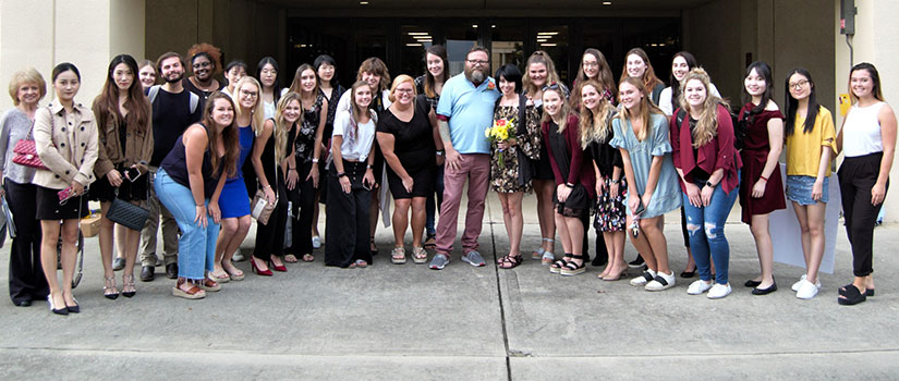 Engaged couple Jillian Owen and Brad Morris pose with students from Instructor Annette Hoover's wedding planning class, HRTM 362. Each fall, students in the class choose a lucky couple to receive a free wedding.