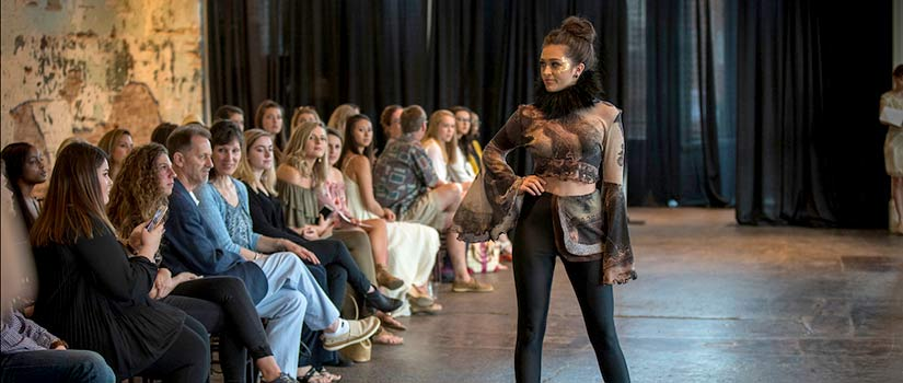 A student models a design at the USC Fashion Board Designer Showcase fashion show.