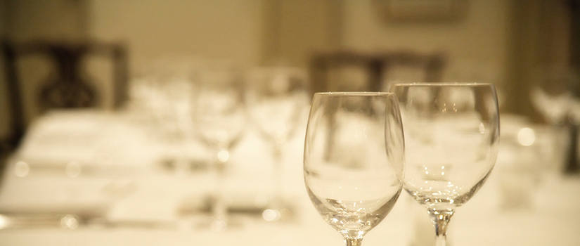 Generic image close up of water and wine glasses on a table.