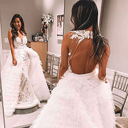 Michelle Doan spent her summer interning at Kleinfeld Bridal. Here she looks into a floor length mirror while wearing a Kleinfeld original wedding gown.