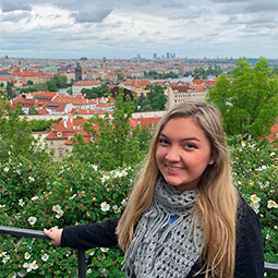 Jessica Rhinesmith traveled to the Czech Republic this summer. Here she poses on an overlook of a beautiful city.