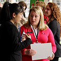 A recruiter meets with a student during the HRSM Experience Expo