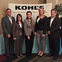 Kohl's executives stand in front of their company banner. Kohls employees offer an evening of sessions about dressing for success.