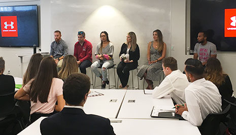 Students listen as a panel of Under Armour employees, who are also HRSM alumni, field questions about working for the sporting goods company.